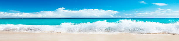 Beautiful beach and sea wave in a panoramic image stock photo