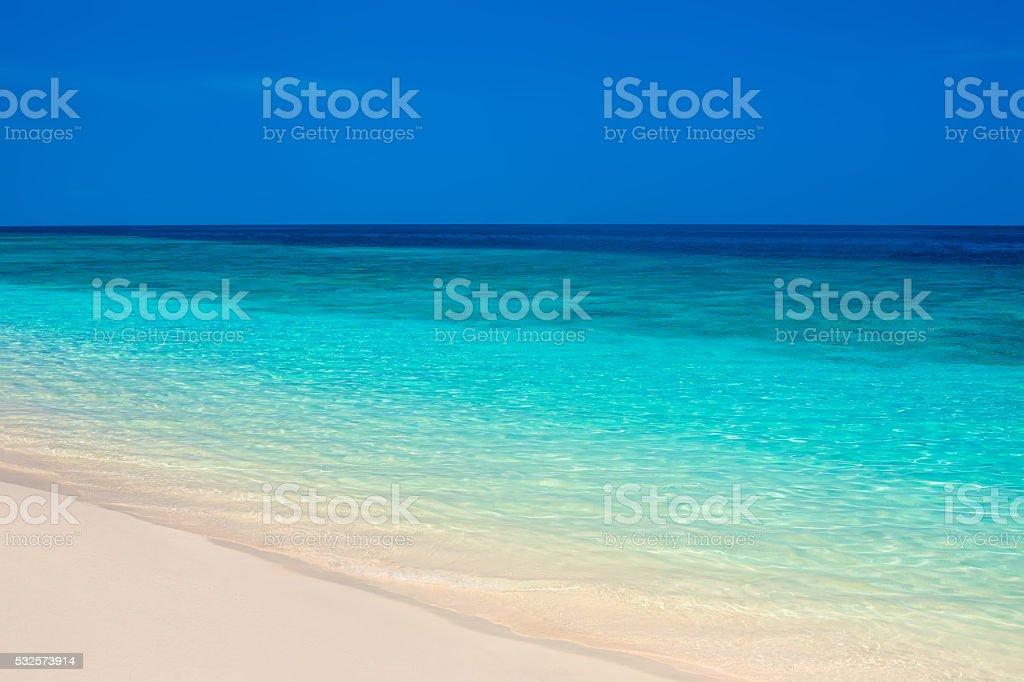 Beautiful beach and tropical turquoise sea stock photo