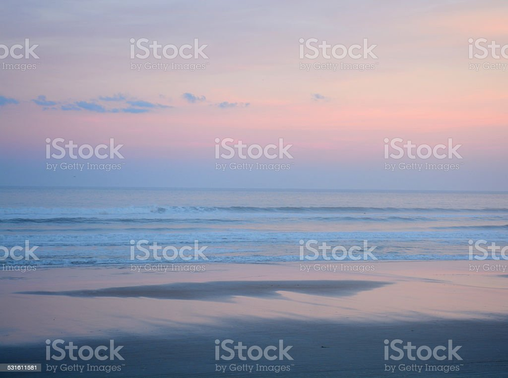 Beautiful beach at sunset. stock photo