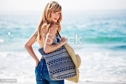 Beautiful beach babe with bag, portrait