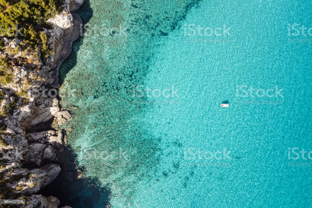 Beautiful beach, coast and bay with crystal clear sea water seen from above stock photo