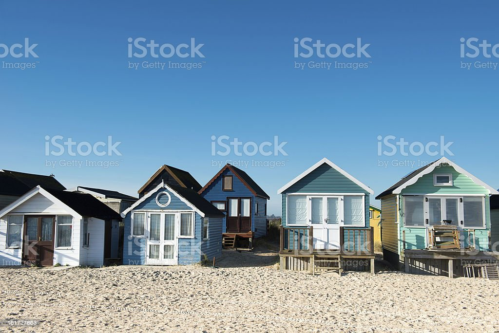 Beautiful beach huts near the shores on a sunny day stock photo
