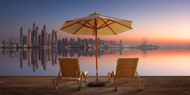 Beautiful beach in Dubai with the skyline of Dubai Marina on the horizon stock photo