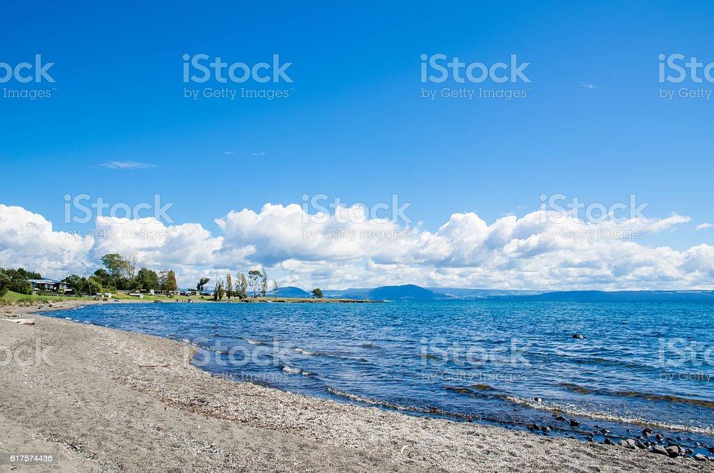 Beautiful beach side of Lake Taupo in New Zealand. stock photo