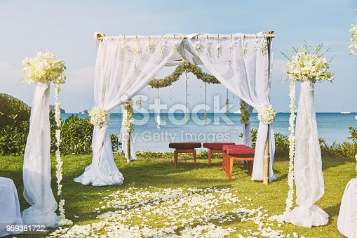 istock Beautiful beach wedding flower arch setting for wedding venue with panoramic ocean view 959381722