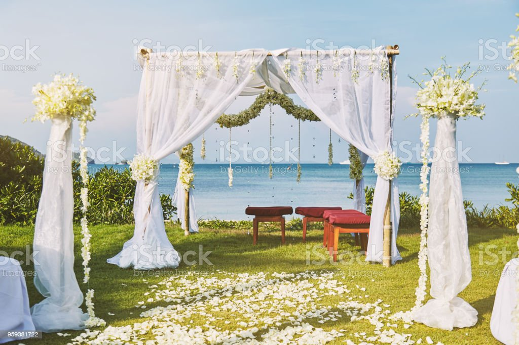 Beautiful beach wedding flower arch setting for wedding venue with panoramic ocean view stock photo