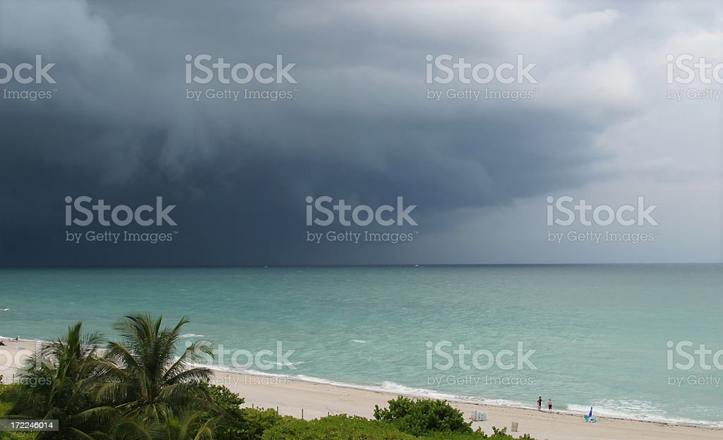 A beautiful beach with a cloudy storm royalty-free stock photo