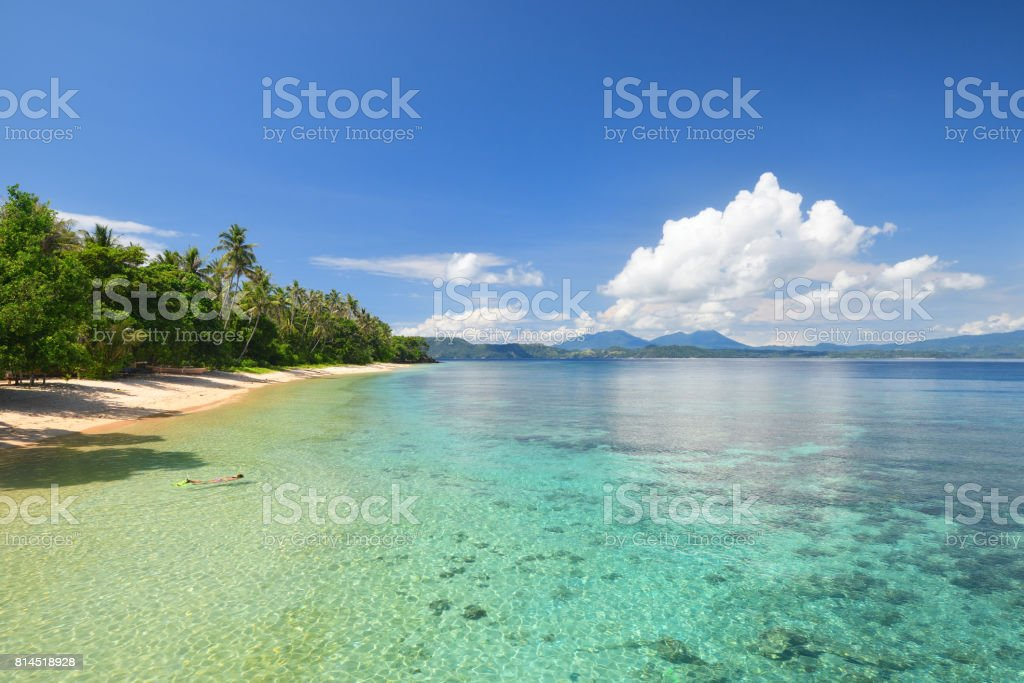 Beautiful beach with a coral reef on a tropical island stock photo
