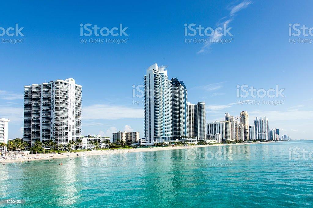 beautiful beach with condominiums and skyscraper in Sunny Island stock photo