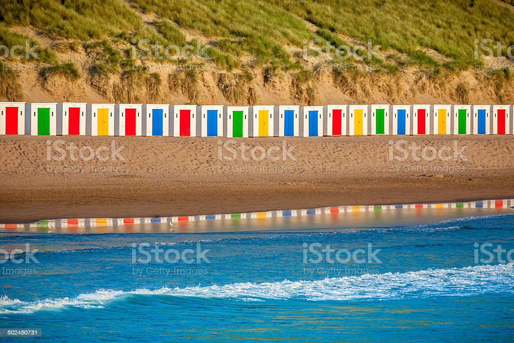 Beautiful Beah Huts Reflecting In The Water stock photo