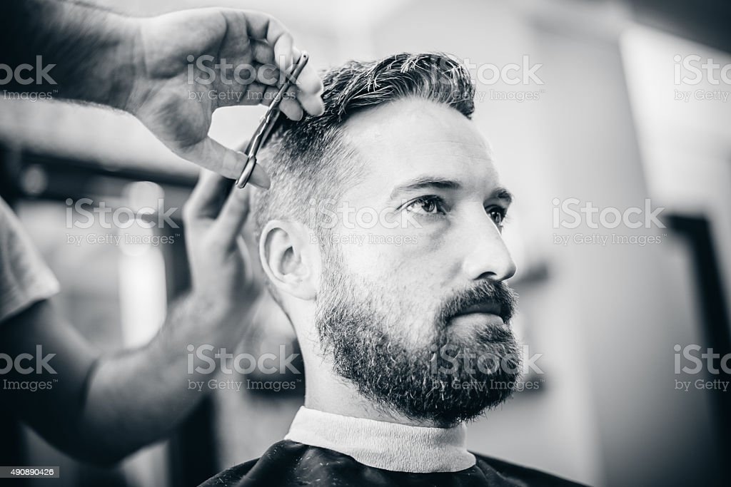 Beautiful Bearded Man Getting Hair Cut In Barber Shop Stock Photo