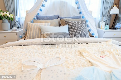 istock Beautiful bedroom girl with an angle wings and dress on the bed. 950603014