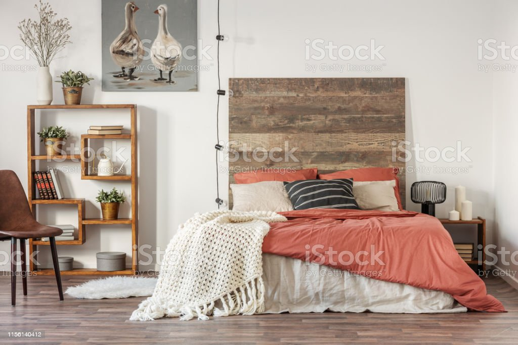 Beautiful bedroom interior with king size bed wooden headboard