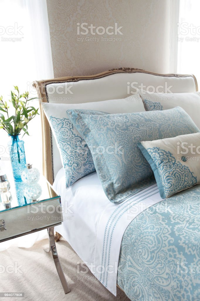 Beautiful bedroom with blue colored beddings and pillows