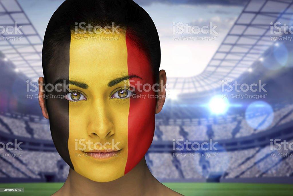 Beautiful belgian fan in face paint stock photo