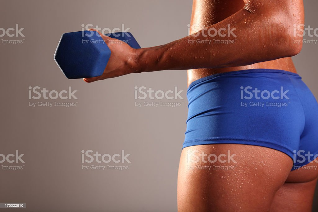 Beautiful Bicep Exercise with Dumbell in Gym Workout royalty-free stock photo