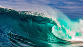A snapshot in time of a big wave crashing