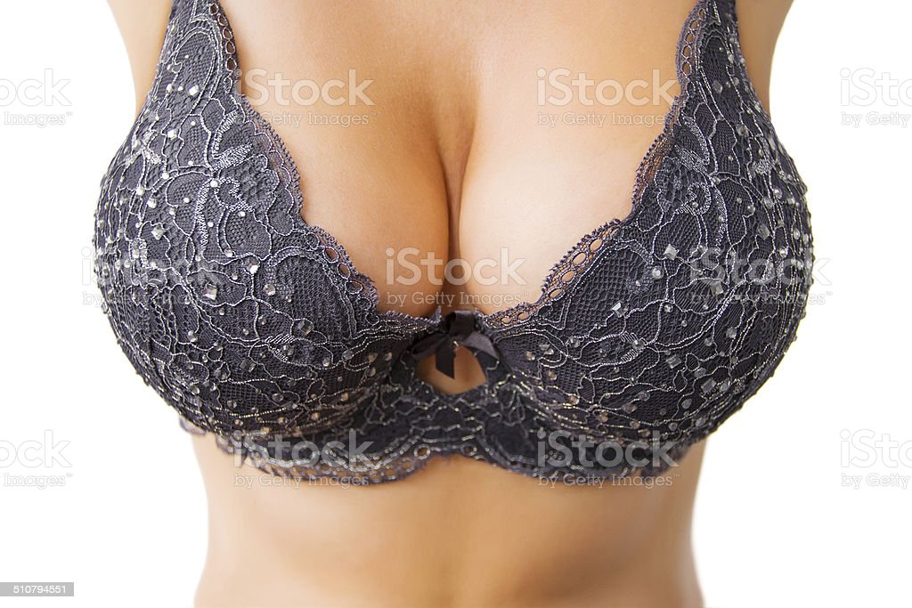 Beautiful big women's breasts in black bra​​​ foto