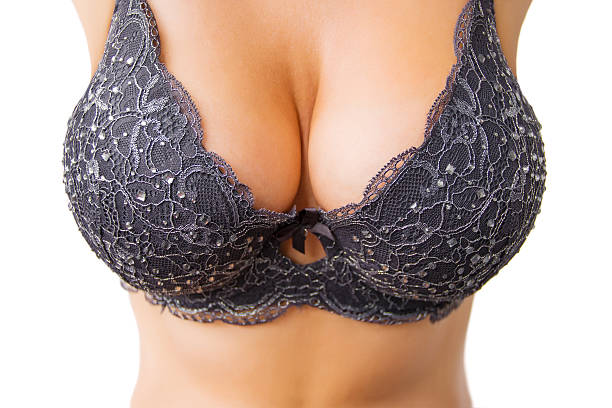 Beautiful big women's breasts in black bra stock photo