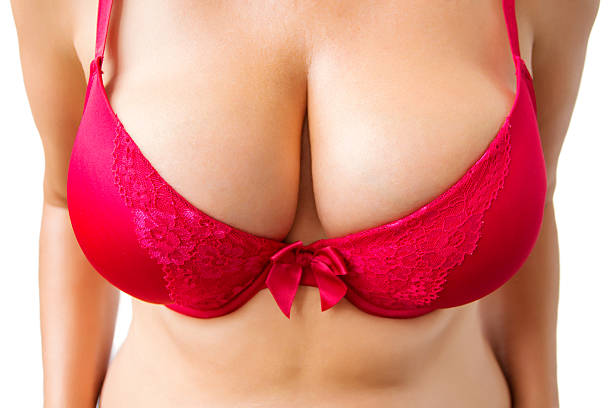 Beautiful big women's breasts in red bra stock photo
