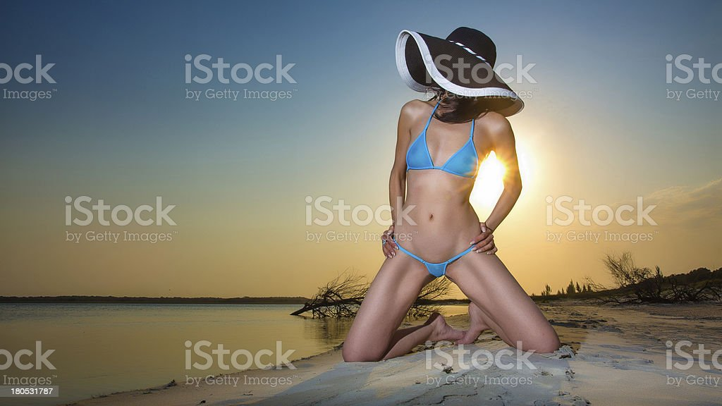 Beautiful bikini babe at sunset stock photo