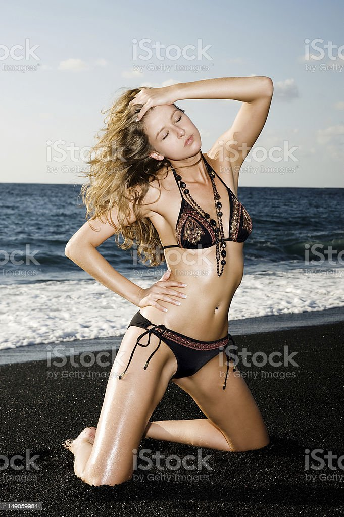 Beautiful bikini model on the beach royalty-free stock photo