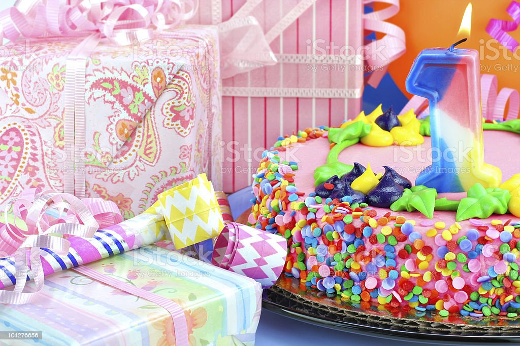 Beautiful Birthday Party Cake With Lit Number One Candle Stock Photo