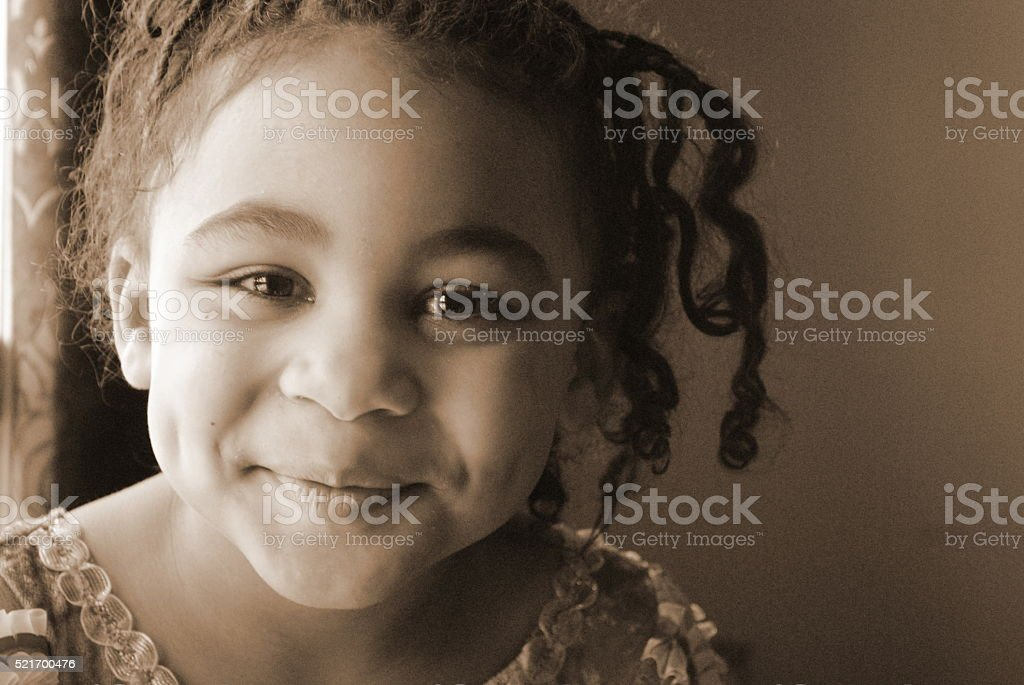 Beautiful Black Girl in Sepia stock photo