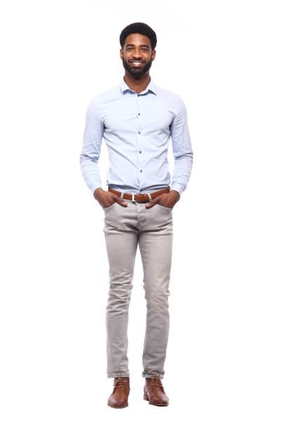 schöner schwarzer mann vor einem farbigen hintergrund - geschäftskleidung stock-fotos und bilder