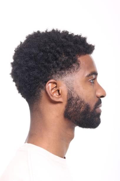 Beautiful black man Beautiful black man high key stock pictures, royalty-free photos & images