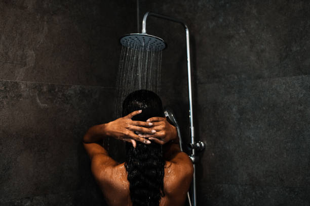 Beautiful black woman at the shower stock photo