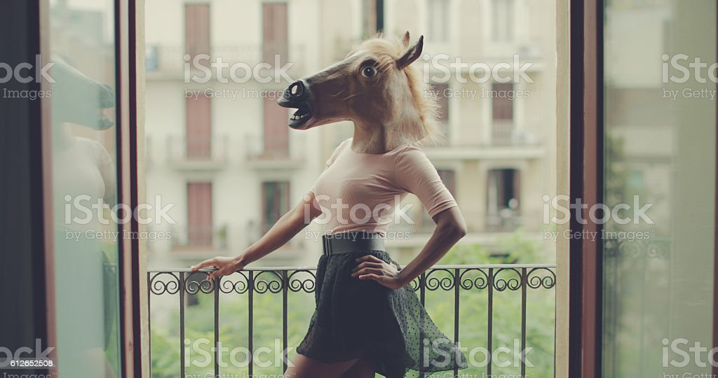Beautiful black woman portrait with horse head stock photo