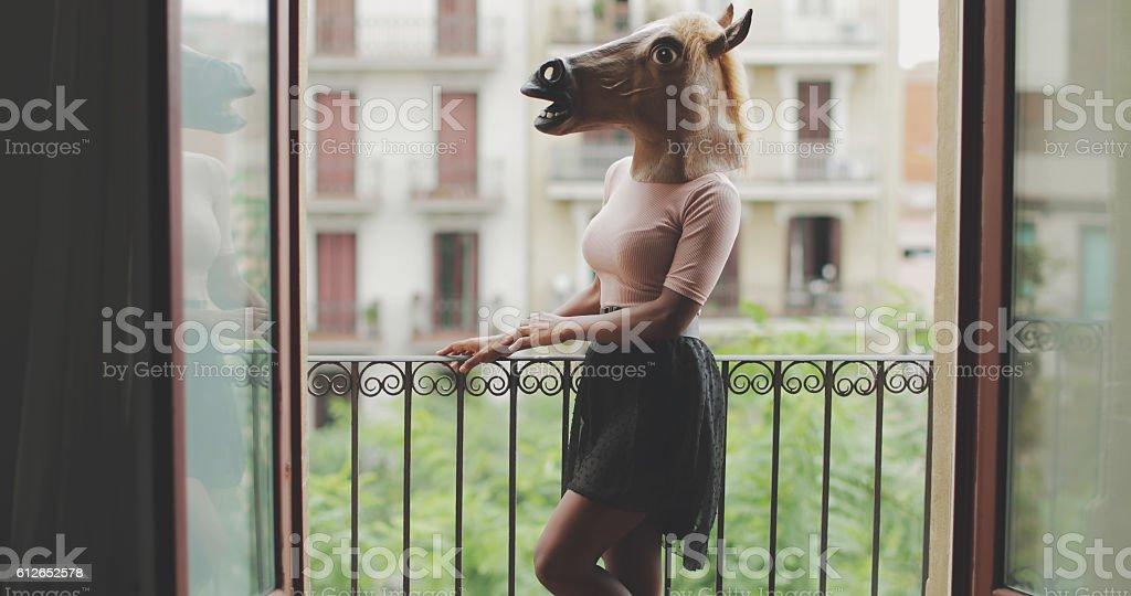 Beautiful black woman portrait with horse head stock photo