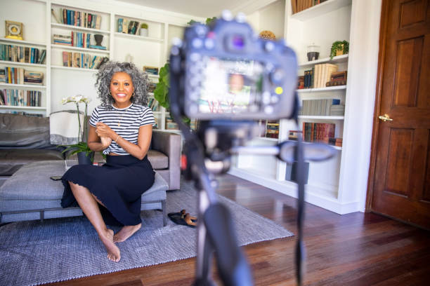 beautiful black woman recording a video - side hustle stock pictures, royalty-free photos & images
