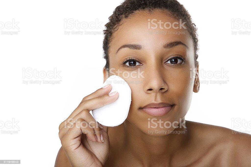 Beautiful black woman removing make up stock photo