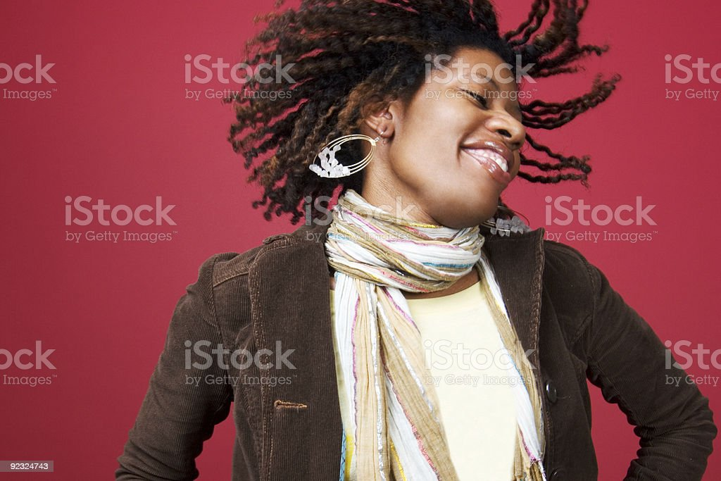 Beautiful black woman shaking her head with flying hair stock photo