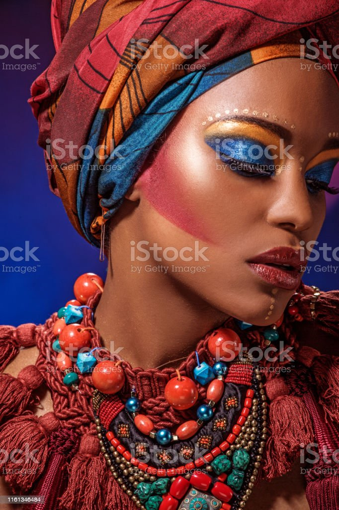 Portrait of a Beautiful Black Woman wearing african head wrap and...