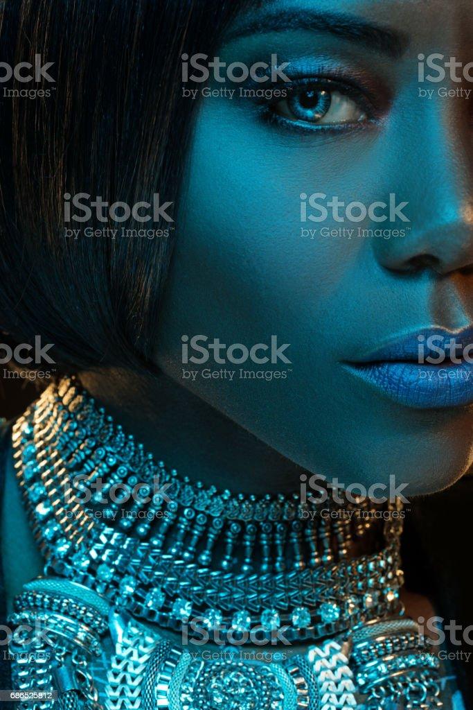 Beautiful Black Woman wearing jewellery in Studio Setting stock photo