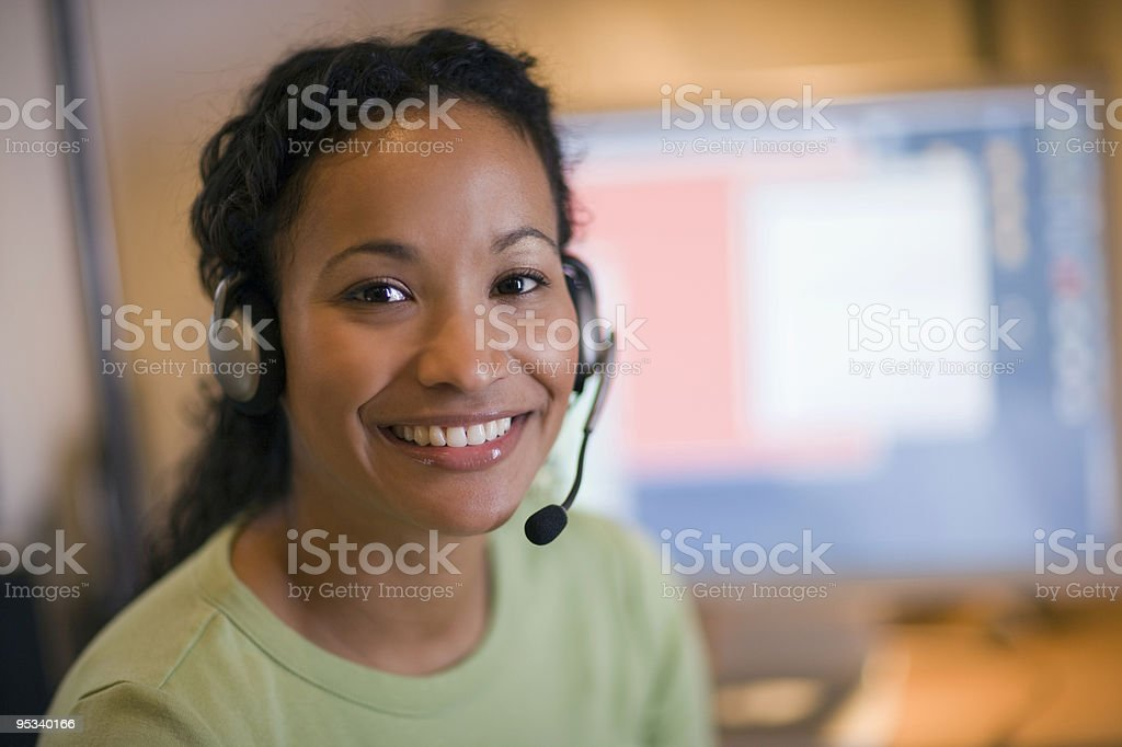 Beautiful black woman with headset Smiling young African American woman with headset and microphone Accessibility Stock Photo