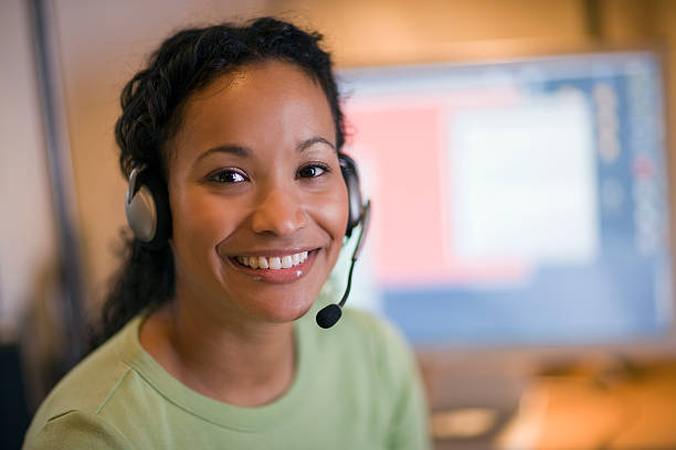 Beautiful black woman with headset stock photo