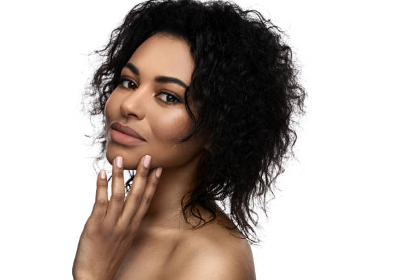 Beautiful black woman with smooth skin on white background stock photo