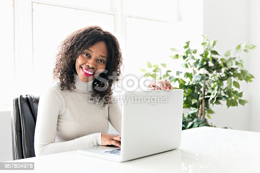istock Beautiful black woman working on self employee office 957804978
