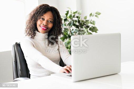 istock Beautiful black woman working on self employee office 957805062