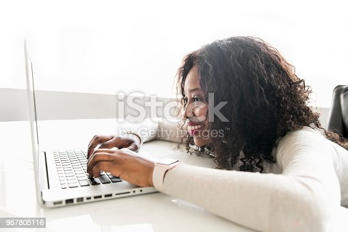 istock Beautiful black woman working on self employee office 957805116