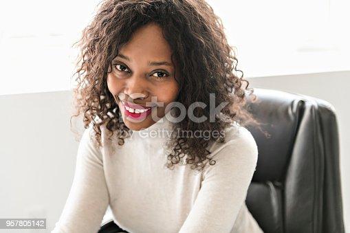 istock Beautiful black woman working on self employee office 957805142