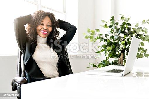 istock Beautiful black woman working on self employee office 957805220