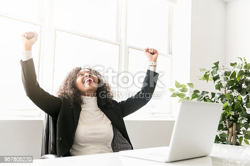 istock Beautiful black woman working on self employee office 957805270