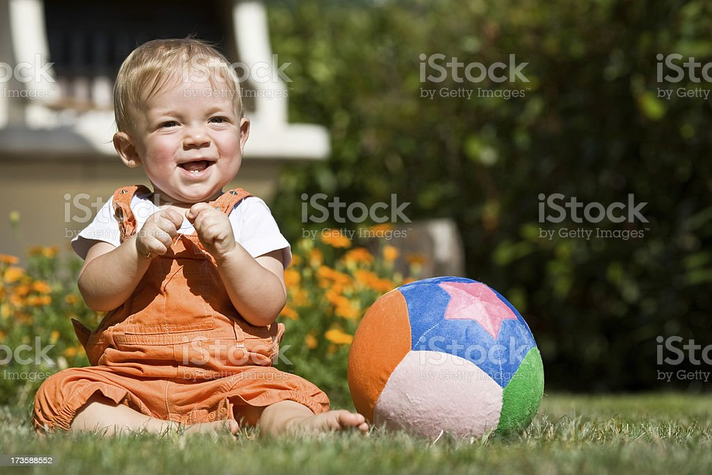 beautiful blond baby child with ball fun outdoor in garden royalty-free stock photo