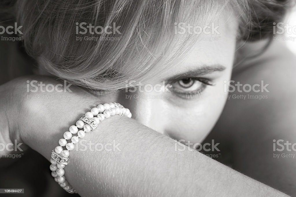 Beautiful blond bride looking from behind her arm royalty-free stock photo