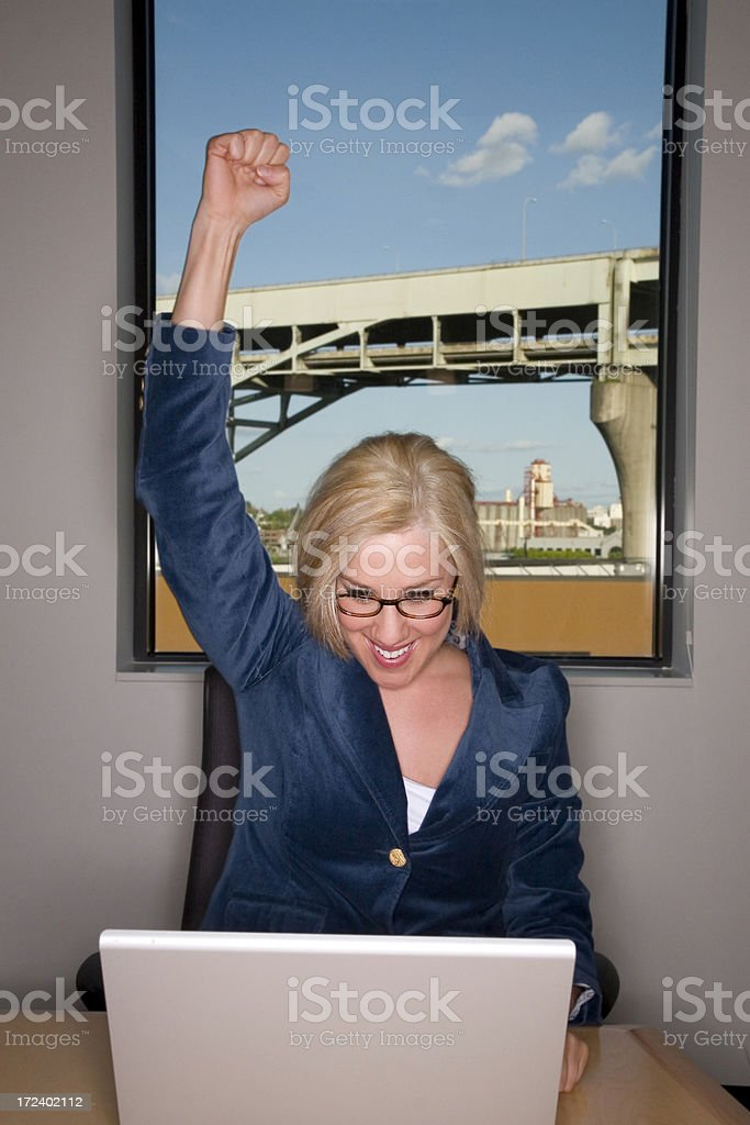 Beautiful Blond Businesswoman Pumping Fist While Using Laptop, Copyspace royalty-free stock photo